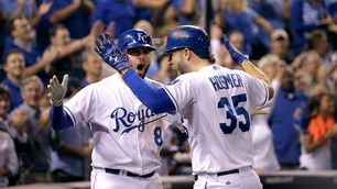 Kansas City Royals' Eric Hosmer (35) celebrates with Mike Moustakas after hitting a solo home run to tie the score during the fifth inning of a baseball game against the Seattle Mariners on Thursday, Sept. 24, 2015, in Kansas City, Mo. (AP Photo/Charlie Riedel)