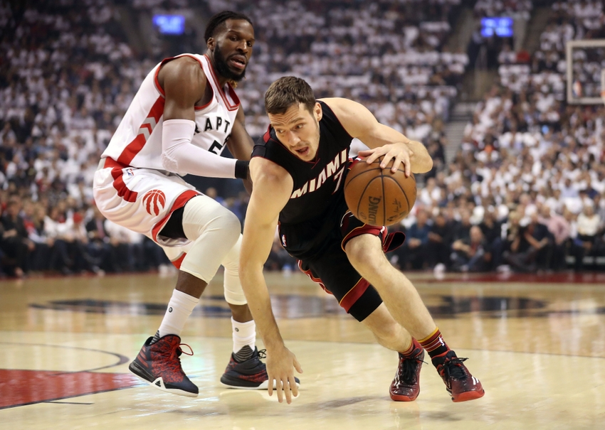 9290903-goran-dragic-demarre-carroll-nba-playoffs-miami-heat-toronto-raptors