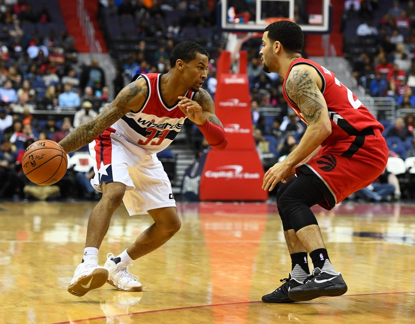 9623686-trey-burke-fred-vanvleet-nba-preseason-toronto-raptors-washington-wizards-1