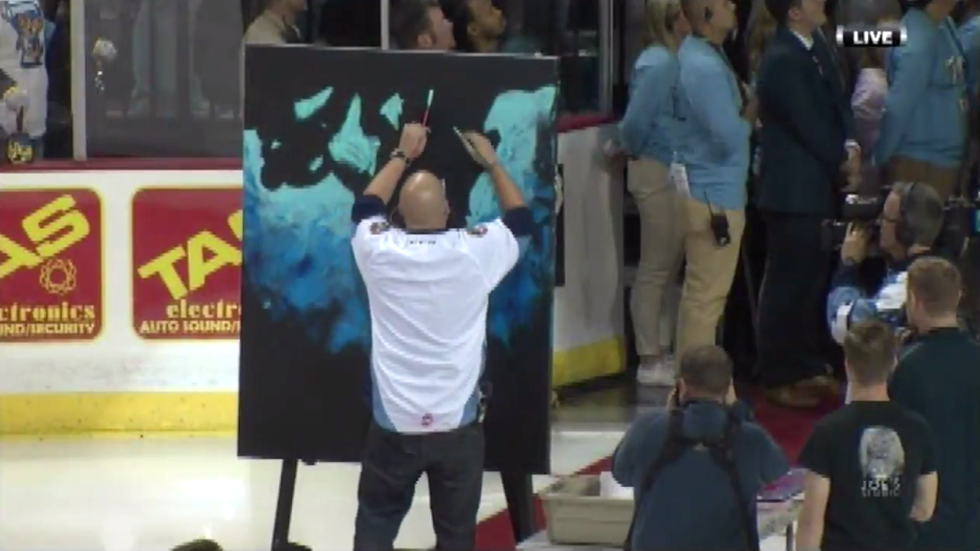 ECHL: Watch Man Sing National Anthem While Painting Canvas During Hockey Game