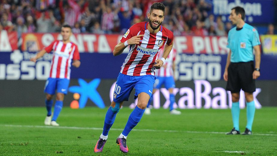 MADRID, SPAIN - OCTOBER 15:  Yannick Carrasco of Club Atletico de Madrid celebrates after scoring his 3rd goal during the La Liga match between Club Atletico de Madrid and Granada CF at Vicente Calderon Stadium on October 15, 2016 in Madrid, Spain.  (Photo by Denis Doyle/Getty Images)
